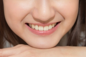 Forrás: freedigitalphotos.net, Close-up Asian Woman Smiling With White Teeth by tiverylucky